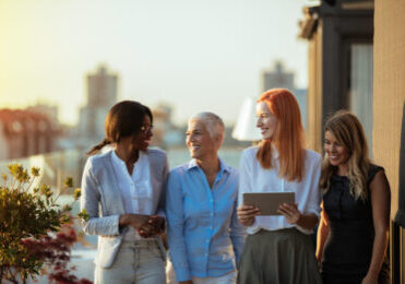 Business women having a conversation on the rooftop.